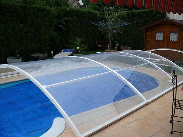 Montage de l 39 abri de piscine construction d 39 une piscine for Abri piscine waterair