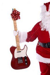 ist2_4595110-santa-claus-with-guitar.jpg