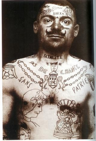 photo: extraite du livre 1000 tattoos d'Henk SCHIFFMACHER.