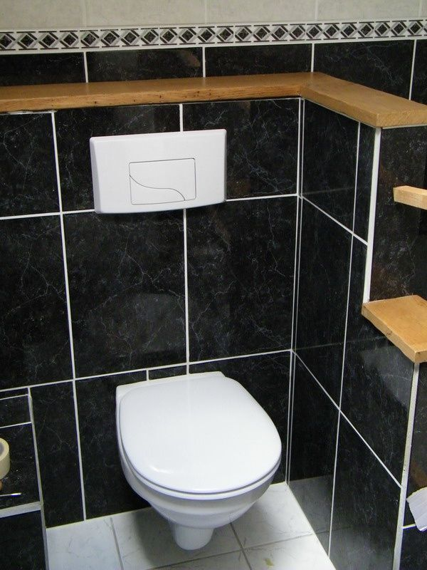 Wc suspendu carrelage noir for Carrelage pour wc suspendu