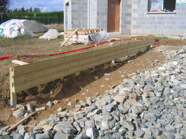 1er octobre 2006 muret bois construction maison for Habillage cloture beton