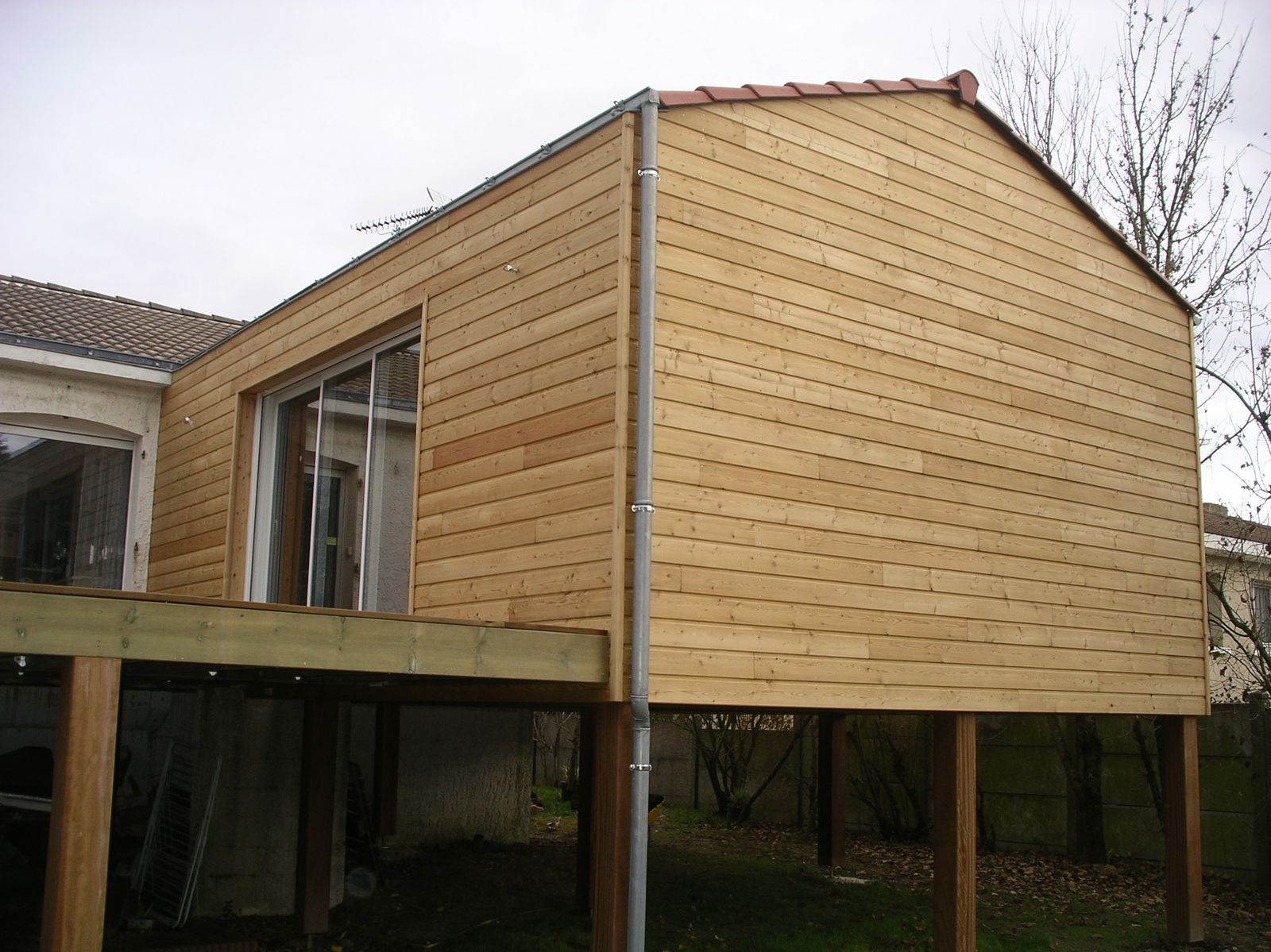 Extension maison bois sur pilotis for Cout agrandissement garage