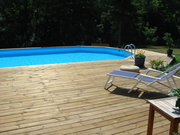 Album chantier piscine terrasse bois le blog for Construction piscine 38