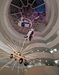 Cai Guo-Qiang Inopportune: Stage One, 2004 Nine cars and sequenced multichannel light tubes - Seattle Art Museum, Gift of Robert M. Arnold, in honor of the 75th Anniversary of the Seattle Art Museum, 2006 - Exhibition copy installed at Solomon R. Guggenheim Museum, New York, 2008 - © Solomon R. Guggenheim Foundation New York. Photo by David Heald.