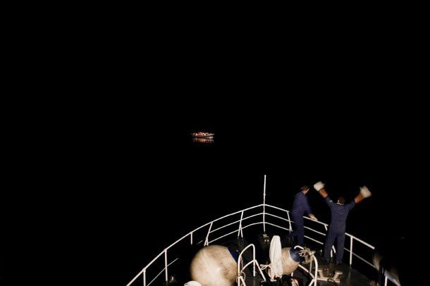 Mashid Mohadjerin, Belgium, Reporters/Redux Pictures. Coastguards spot a boat with refugees, off Lampedusa, Italy, 30 July