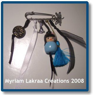 Fimo : broche-grigri, mars 2008 - Myriam Lakraa Créations