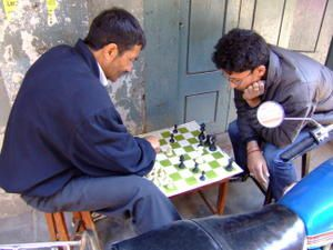 029-Shopkeeper-playing-chess-with-a-friend-Ktm.jpg