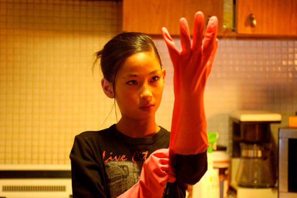 12_and_holding_Malee_glove.jpg