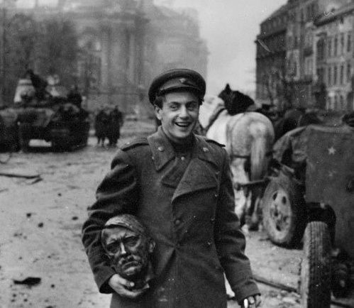 eSoviet-soldier-carrying-the-head-of-a-statue-of-Hitler--B.jpeg