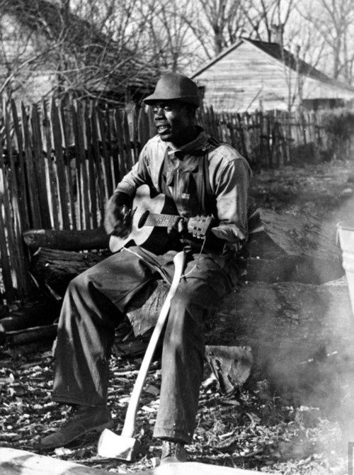 A-young-African-American-sharecropper-playing-the-guitar-a.jpeg