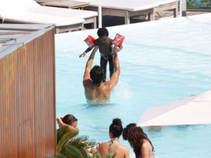 Jesus Luz at the swimming pool in Rio with Madonna's daughters