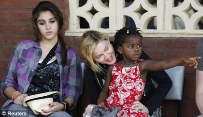 Madonna returns to Malawi to lay first brick of a new girls' school