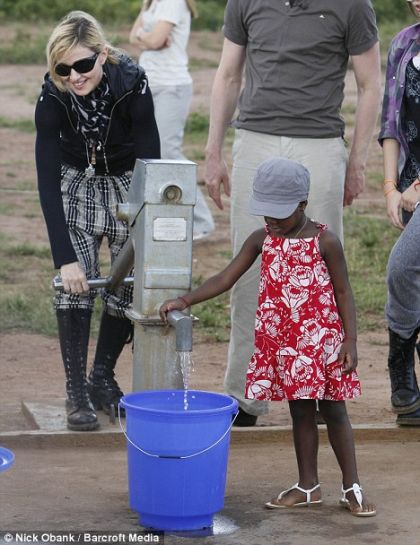 Madonna tests a new pump in the Mchinji district of Malawi