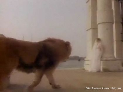 On the set of ''Like A Virgin'' video: Madonna and the lion