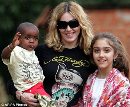 Madonna with adopted son David Banda and daughter Lourdes