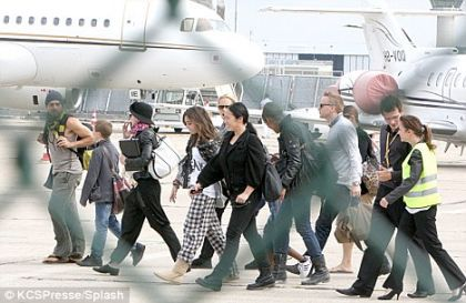 Madonna and her children board their private jet in Paris