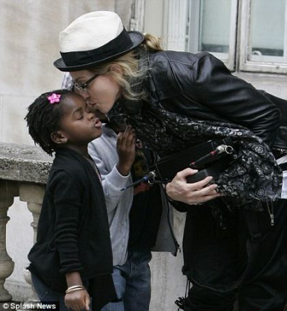 Madonna kisses her daughter Mercy, London - August 8, 2010