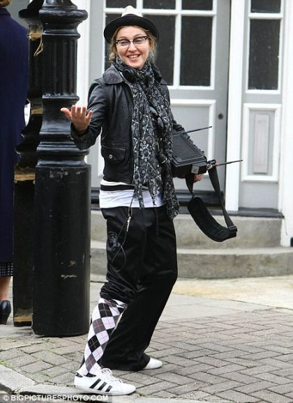 Madonna with one trouser leg pulled up, London - August 8, 2010