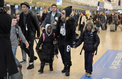 Madonna, Brahim and the kids head home after Swiss holiday