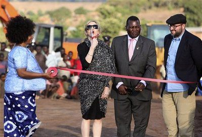 Madonna plants tree, cuts ribbon at Groundbreaking Ceremony for Girls School in Malawi