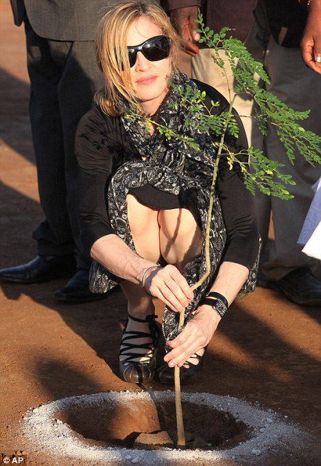The pop star plants a tree at a ground breaking ceremony for her Raising Malawi Academy for Girls in Malawi