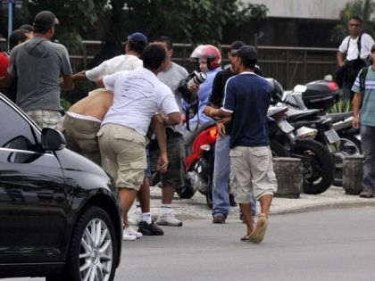 Paparazzi fight at Madonna's hotel in Rio, Brazil on Nov. 11, 2009