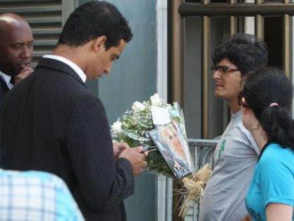 Fans trying to deliver flowers for Madonna in Rio on Nov. 13, 2009