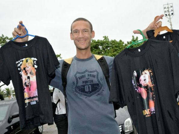 Itinerant salesmen take advantage of Madonna's visit to make money
