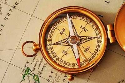 antique-brass-compass-over-old-canadian-map-2.jpg