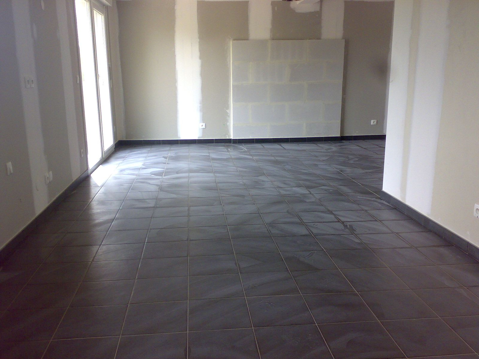 Carrelage termin construction maison batig re for Carrelage diagonale