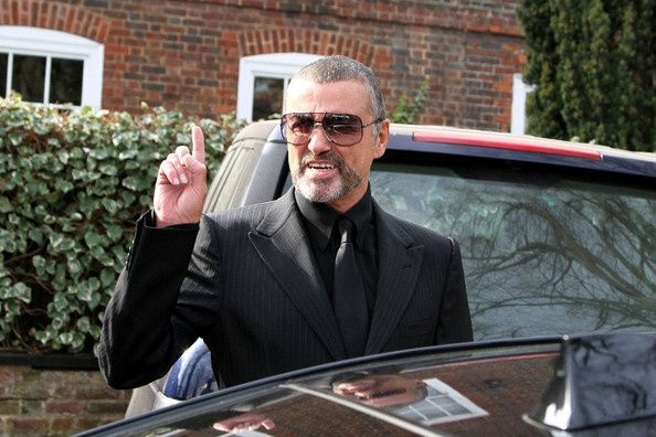 George-Michael-is-all-smiles-Bd4qTZ2_U7Rl.jpg