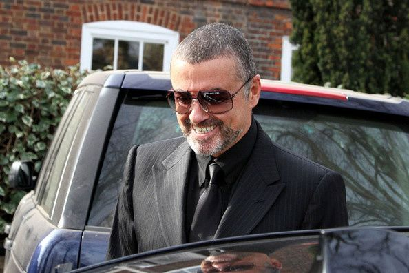 George-Michael-is-all-smiles-Wn-pd8oYaD-l.jpg