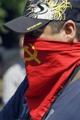 2233508881-a-demonstrator-wears-a-mask-during-a-free-the-st.jpg