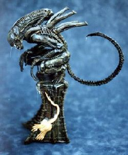 pedestal-alien-warrioir-crouching-on-tall-base.jpg