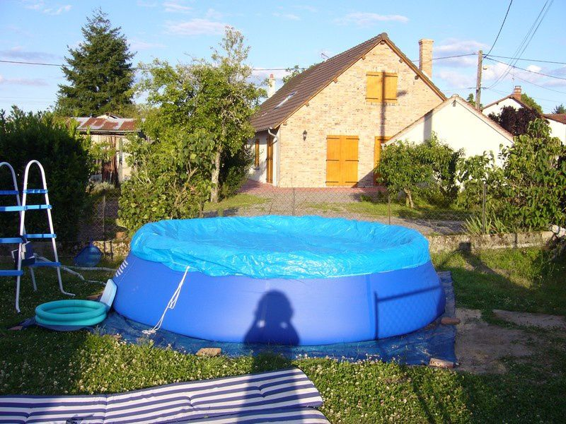 L 39 installation d 39 une piscine auto portante tout un for Calcul m3 piscine