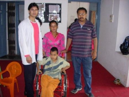 Prakash Thapa with wheel chair donated by SSA during the ca