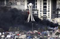 bahrain-forces-expel-protesters-clashes-kill-5-2011-03-16_l.jpg