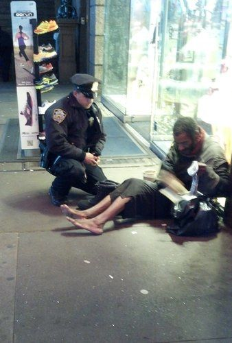 Officer Lawrence DePrimo and a homeless