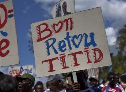 4072713249-supporters-of-haiti-s-ousted-president-jean-bert.jpg