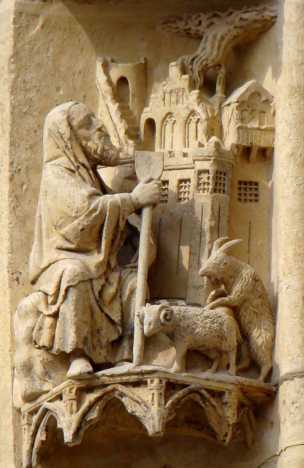 Amos en berger (manteau à capuchon, houlette et bétail à ses pieds) voit les maisons détruites par le feu. Cathédrale d'Amiens