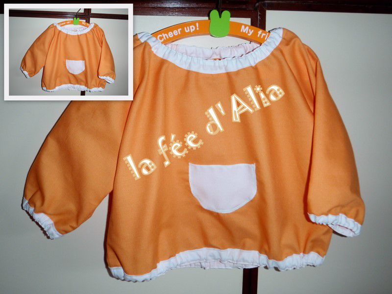 blouse orange taille 1 an