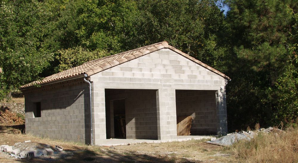 Place des devis for Construire un garage contre une maison