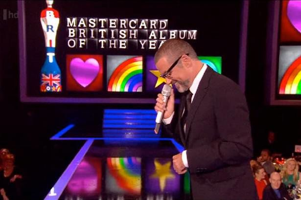 George-Michael-presents-the-British-Album-of-the-Year-award.jpg