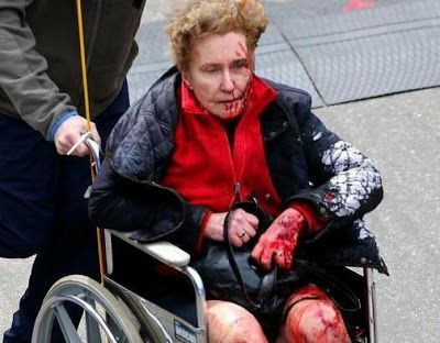 boston-bombing-bloodied-woman-in-wheelchair.jpg