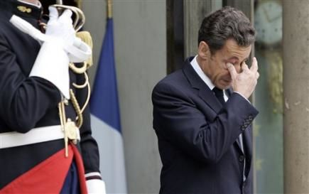 888892451-french-president-nicolas-sarkozy-gestures-as-he-w