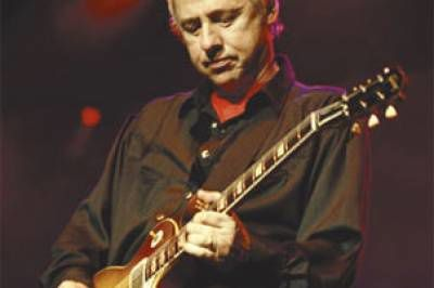 mark-knopfler-scndw4.jpg.pagespeed.ce.ChLEY8wsqo.jpg