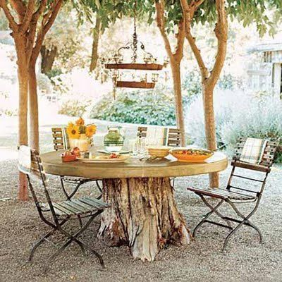 outdoor dining table with chandelier - tree trunk table bas