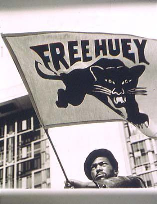 black-panther-party-member-carrying-free-huey-flag-Jonathan.jpg