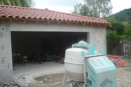 Installation couverture charpente garage construire for Construire son garage soi meme