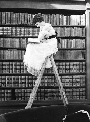 -_woman_reading_on_top_of_ladder_-_1920.jpg